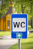 WC or toilet sign with retro house Stock Photography