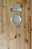 WC toilet wooden door. Stock Photography
