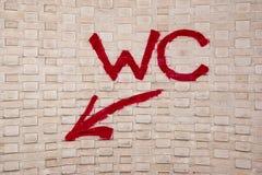 WC van graffitiart urban wall sign met Pijl Stock Afbeelding