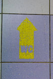 WC. Yellow WC Arrow Sign on the floor background Royalty Free Stock Photography