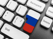Wchodzić do klucza guzika z flaga Rosja Fotografia Stock