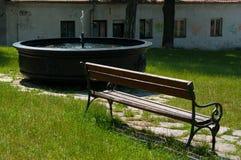 Wciąż życie z ławką i fontanną Zdjęcia Royalty Free