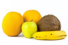 Wciąż życie z owoc na bielu: banan, pomarańcze, jabłko, koks Obraz Royalty Free