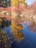 Wciąż woda w jesieni Fotografia Royalty Free
