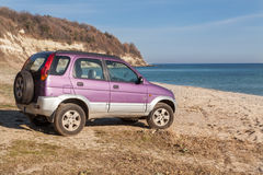 4wd car, SUV on the wild beach. Vacation, adventure concept. Royalty Free Stock Photography