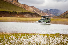 4WD car wades river in Iceland. 4WD car wades river in Landmannalaugar, Iceland Stock Photography