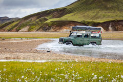4WD car wades river in Landmannalaugar in Iceland Stock Photos