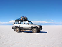 4wd expedition vehicle on the Salar Royalty Free Stock Image