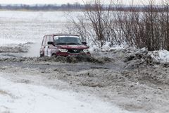 4WD rally car overcomes a half-frozen pond Royalty Free Stock Images