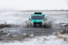 4WD rally truck overcomes a half-frozen pond Royalty Free Stock Image