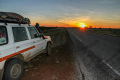 4WD at sunset. 4WD parked next to an empty road at sunset in the Kimberley region of Australia Royalty Free Stock Photography