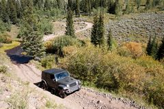 4WD vehicle driving through rugged terrain Royalty Free Stock Photography