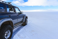 4WD vehicle. Going through snow Stock Photography
