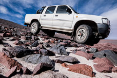 4WD vehicle. Off-road 4WD car driving on rough terrain Royalty Free Stock Photo