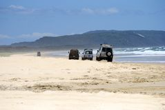 4WD vehicles driving on 40-mile beach in Great Sandy National Pa stock images
