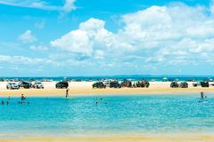 4wd vehicles at Rainbow Beach with coloured sand dunes, QLD, Australia. Rainbow Beach, QLD, Australia- December 30, 2017: 4wd vehicles at Rainbow Beach, a stock photography