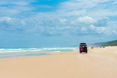 4wd vehicles at Rainbow Beach with coloured sand dunes, QLD, Australia. Rainbow Beach, QLD, Australia- December 30, 2017: 4wd vehicles at Rainbow Beach, a royalty free stock photos