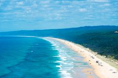4wd vehicles at Rainbow Beach with coloured sand dunes, QLD, Australia Royalty Free Stock Images