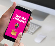 WE'RE HIRING   Business Team and Group of People Message Talki Stock Image