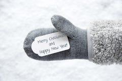 Wełny rękawiczka, etykietka, śnieg, Wesoło boże narodzenia I Szczęśliwy nowy rok, zdjęcia stock