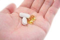 weź tabletki ręka Fotografia Stock