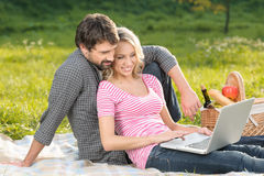 We Are Always In Touch. Loving Young Couple Taking The Photographs Of Themselves On Summer Picnic Royalty Free Stock Image