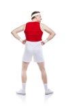Weak body builder. Funny weak body builder tries to exercise. Studio shot on white background Stock Photography