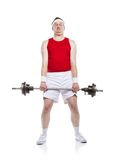 Weak body builder. Funny weak body builder tries to lift a weight. Studio shot on white background Stock Image