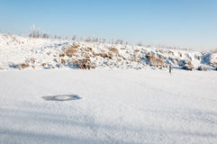 Weak circular spot in the snow covered ice Stock Images