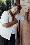 Weak grandmother with heart attack waiting royalty free stock image
