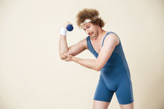 Weak man can`t make it. Working out with ligt dumbbell royalty free stock photo