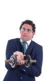 Weak man with expression in suit lifting a weight Stock Photo