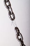 Weakest link. In a chain. concept of genuine software (machine part, team player, etc) makes difference Stock Photos