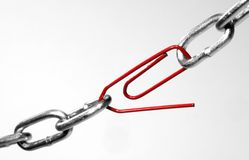 The weakest link. Chain patched with a paper-clip Royalty Free Stock Image