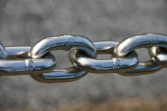 Weakest Link. Closeup of silver chain links used for crowd control pulling or towing or symbol of strength Stock Images