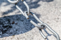 The weakest link. The link in the chain is opening: this weak link defines the real strength of this steel chain Royalty Free Stock Photo