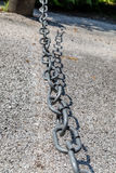 The weakest link. The link in the chain is opening: this weak link defines the real strength of this steel chain Stock Photos