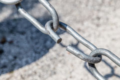 The weakest link. The link in the chain is opening: this weak link defines the real strength of this steel chain Royalty Free Stock Image