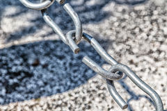 The weakest link. The link in the chain is opening: this weak link defines the real strength of this steel chain Stock Images