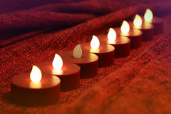 The Weakest Link. Composition based on a series of small candle-lights. The prospect. Focus Stock Photo