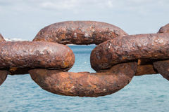 The weakest link. An old rusted chain link at the waterfront Stock Images