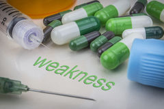 Weakness, medicines and syringes as concept Royalty Free Stock Images