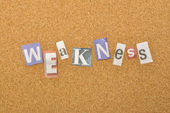 Weakness Word Made From Newspaper Letter. Shot over pinboard background Stock Images