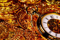 Wealth. Pocketwatch and Gold Coins Royalty Free Stock Image