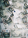 Wealth. Closeup on many scattered fifty euro banknotes in sepia tone. Wealth and prosperity concept Stock Photos