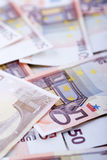 Wealth. Closeup on many scattered fifty euro banknotes. Wealth and prosperity concept Royalty Free Stock Photo