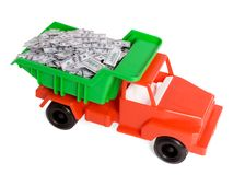 Wealth. Lorry full of money isolated on white royalty free stock photo
