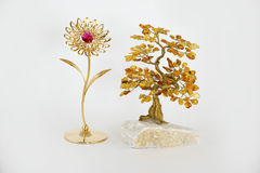 Wealth. Amber bonsai and gold flower on white background Royalty Free Stock Photos
