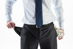 Wealth or bankruptcy?. Businessman with a pocket full of money and an empty pocket Royalty Free Stock Photos
