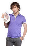 Wealth boy holds cash Royalty Free Stock Photo